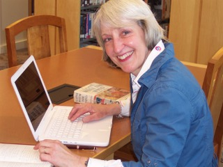 Martha Miller writing book notes at WV Library.jpeg